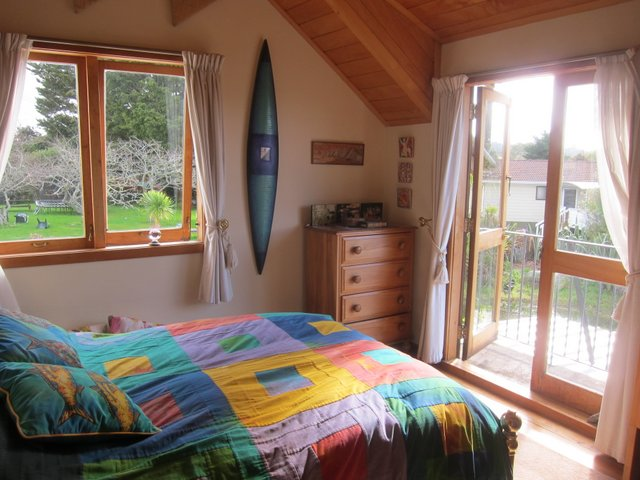 6. upstairs bedroom with small deck