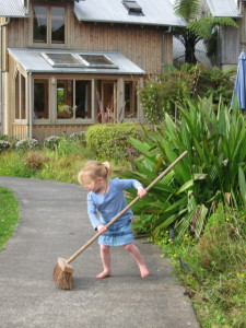 3-year-old Phoebe sweeping the path to our house after her grandmother weeded the swale