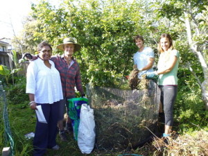 Farida, with Eric and Suria, wwoofers, at Tanya's compost-making  demo