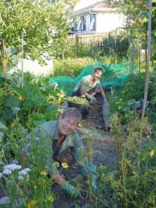 Julie (foreground) and Suria, wwoofer, weeding
