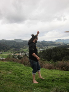 Jamie Watson swinging a purerehua